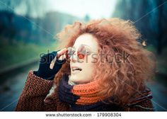 young beautiful red curly hair woman with sunglasses at the park - stock photo BUY IT FROM $1
