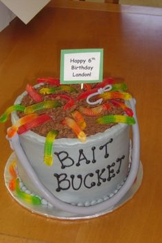 Real Ice bucket Towel and fishing items with a can of beer as a birthday cake! But can be made all out of cake to look like this for your fisherman