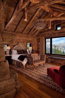 'Log cabin bedroom in the mountains! LOOK at that view!