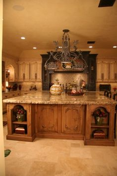 Like The Stove Area With Display Cabinets On Each Side In A Different  Finish Than The Rest Of The Kitchen. Old World Kitchen   Mediterranean    Kitchen ...