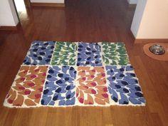 Quadrotti di campionario uniti per formare un tappeto chip
