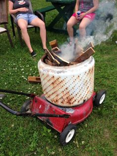 Washer drum + old mower deck = portable fire pit. LOVE IT!