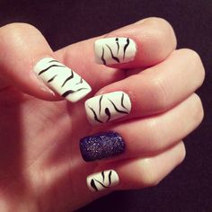Zebra and blue nails with sparkles!