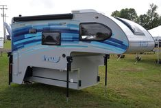 nuCamp unveils a highly innovate prototype hard-side truck camper. Do not miss the ingenious circular wet bath. Short Bed Truck Camper, Best Truck Camper, Slide In Truck Campers, Truck Camper Shells, Pickup Camper, Off Road Camper, Truck Camping, Camper Van Shower, Outback Campers