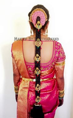 Traditional Southern Indian bride's bridal braid hair. Hairstyle by Swank…