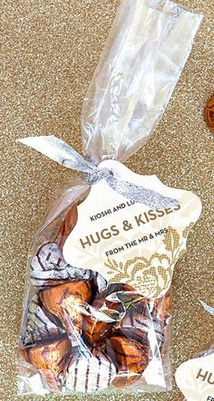 Little paper bags with our initials and wedding date on it at the candy buffet. Hugs and Kisses Wedding Favors