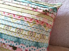 pleated pillow cover- but do in 2 coordinating colors instead of so many different.