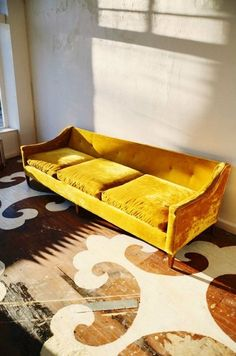 yellow mustard velvet couch, painted floor wood --- modern bohemian boho interior design / vintage and mod mix with nature, wood-tones and bright accent colors / anthropologie-inspired chic mid-century home decor