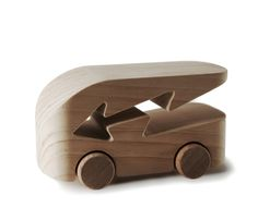 """Denis Santachiara's contribution to the """"100x100"""" project--100 wooden toy cars by 100 designers."""