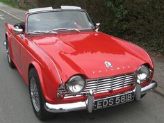 Triumph TR4A - done many miles in a car like this!  Mine had Lucus auxiliary driving lights and tan top.  Mine was a 1963 TR-4 though, but the same style and color