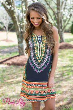 This vibrant tribal print dress is sure to make a splash at all of your summer events! From your vacation adventures to spending time with friends and family, you're sure to love wearing this dress all day long.