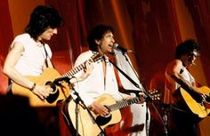 Ronnie Wood, Bob Dylan and Keith Richards perform at Live Aid in Philadelphia. July 13, 1985.