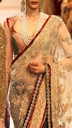 Gold thread embroidery. Touch of deep red velvet is icing on the cake! #wedding #saree