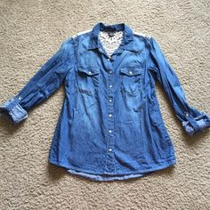 Not your average denim shirt Adorable denim, snap closure shirt, adjustable sleeve length, beautiful lace back. Worn once for a country wedding. Can be belted for tights or skirt and boots. Rue 21 Tops Button Down Shirts
