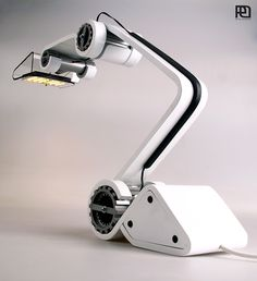 industrial style desk lamp design. Inspired by robots and work machines, etc...