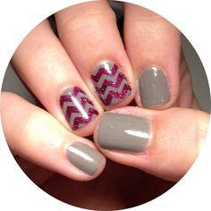 Gray and purple glitter chevron nails.