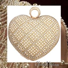 Pearl encrusted gold tone heart clutch Gold tone metal, Pearls cover front and back, hinged and quite weighty. More pics when she arrives this  Friday. Boutique Bags Clutches & Wristlets