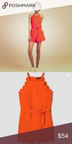 Orange scallop is waist romper Victoria Beckham Womens Orange scallop tie waist romper by Victoria Beckham for target. Measurements bust-42.5 inches . Waist-36 inches , hips-45 inches, length-35 inches. Super cute and bright just in time for summer **no trades thank you 🌴🌴 Victoria Beckham for Target Shorts