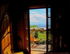 A play of #lights and #shadows through a #glassdoor in VALDONICA. View of the magnificent #hills of Maremma