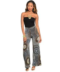 Description This stylish strapless halter jumpsuit features a contrasting slim, stretch fit solid top. The bottom half features a semi flared hem with allover geometric pattern print. 96% Polyester 4%