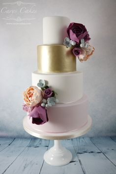 Whether you're looking for something classical or zany and spectacular, the dedicated family behind Carys Cakes are ready to craft the cake of your dreams. Metallic Wedding Cakes, Wedding Cakes With Flowers, Elegant Wedding Cakes, Beautiful Wedding Cakes, Wedding Cake Designs, Beautiful Cakes, Purple Wedding, Amazing Cakes, Themed Wedding Cakes