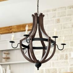 Drama in an airy orb silhouette. The rings of our timeless Beau Orb Chandelier surround five candle arms with streamlined cups and matching candle sleeves. Rivet details and a ring finial add subtle texture. Beau Orb Chandelier features: Bronze finishCrafted of metalUL listed for damp locations