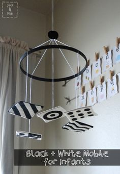 I made one just like this for Eli out of cardboard and paper. He LOVES it! Most mobiles are just cute from the parents perspective, and not interesting from where the baby will be seeing it. Black and white patterns promote vision development, and babies prefer looking at b patterns for the first several months.