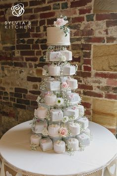 Tower of miniature wedding cakes with a top cutting cake.sylviaskitche… Tower of miniature wedding cakes with a top cutting cake. Iced in pale greys, - Wedding Cake Prices, Small Wedding Cakes, Wedding Cake Rustic, Wedding Cakes With Cupcakes, Wedding Cake Designs, Wedding Desserts, Wedding Ideas Uk, Blue Wedding, Pink And Grey Wedding Cake