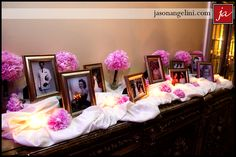 Memory table..... Love this idea I would just have flowers in purple and have some candles lit in front of each photos