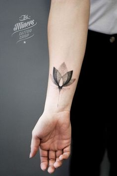 otted Lotus Tattoo on Forearm.