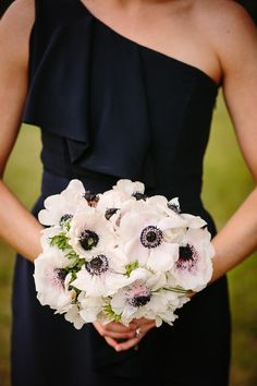 Bridesmaids- navy dresses mixed beautifully with a bouquet full of anemones