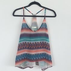 LF Tribal Print Tank Colorful tribal print racer back tank from LF. I bought this a while ago from their sale and haven't worn it so it's in perfect condition. LF Tops Tank Tops