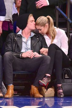 Cody Simpson kisses Gigi Hadid's forehead at the Brooklyn Nets versus New York Knicks game on April 1, 2015, in New York City.   - Cosmopolitan.com