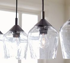 This simple pendant design multiplies light and style over a dining table or island. Kitchen Island Lighting, Kitchen Pendant Lighting, Kitchen Pendants, Farmhouse Pendant Lighting, Multi Light Pendant, Glass Pendant Light, Glass Pendants, Mini Pendant Lights, Chandelier Design