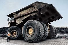 The Caterpillar 797B lugs 400 tons at 40 mph, and chugs 900 gal. of diesel per 12-hour shift at Alberta's Muskeg River oil-sands mine. A single tire costs $60,000.