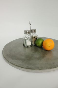 Large Concrete Lazy Susan $85 from TheMakerage on etsy.com. Would love for our giant dining room table.