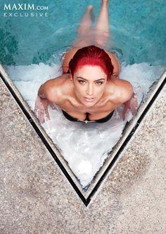 Eva Marie at the V of a pool looking up at camera