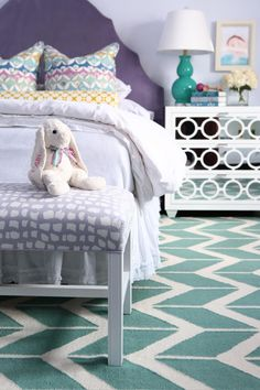 This twin bedroom for two 10-year-old girls was inspired by their favorite colors, blue and purple. Everything was hand-picked by the girls, including the chic custom-made headboards.