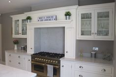 Focus on Kitchen Mantels - Handcrafted Kitchens Shaker Kitchen, Rustic Kitchen, New Kitchen, Kitchen Ideas, Aga Surround, Stainless Steel Hood, Spice Drawer, Old Fireplace, Kitchen Clocks