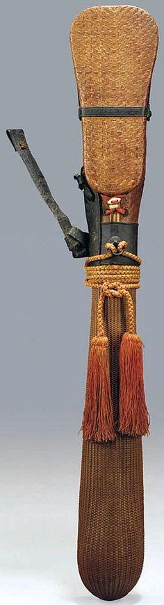 A rattan arrow quiver (utsubo)  Edo period (17th-18th Century), brown woven rattan, 39in. (99cm.) long.