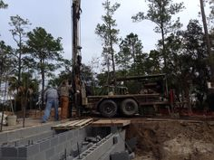 Setting up the drill machine. Homeowner wanted the well drilled inside his house. A first for us!