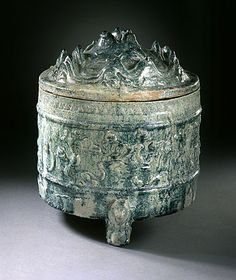 Lidded Jar in the Form of a Mountain Range (Boshan Guan) with Three Feet in the Form of Bears. China, Eastern Han dynasty, 25-220. Molded earthenware with green glaze and applied decoration