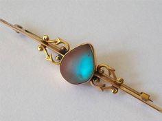 ANTIQUE VICTORIAN 9CT AND SAPHIRET BROOCH