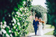 Bride and groom walking, Wedding Photography, Woodhall Manor