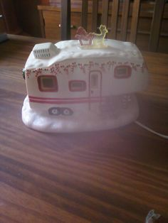 a fifth wheel Christmas camper village piece..a repin. I truly love the stuff this person posts. What an awesome treasure!!!