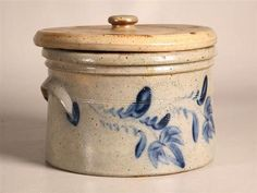 """STONEWARE BUTTER CROCK. American, mid 19th Century. Impressed label """"D.P. Shenfelder, Reading, PA 1 1/2"""". Brushed cobalt blue tulips and two applied handles."""
