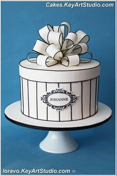 Black and White Striped present Cake with a beautifully made fondant Bow. Hat Box Cake, Gift Box Cakes, Fondant Bow, Fondant Cakes, Cupcake Cakes, Pretty Cakes, Beautiful Cakes, Striped Cake, Bow Cakes