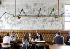 I love the walls and the lighting! + the leather seating. and wood chairs.