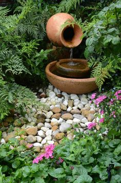 Shade garden with innovative water feature as focal point.