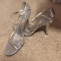 Chinese laundry heels Sparkle and shine this New Year's Eve in these silver heels! Super cute with a small enough heel to last you the whole night. These show traditional signs of wear, however have a ton of life left and still look great on. Chinese Laundry Shoes Heels